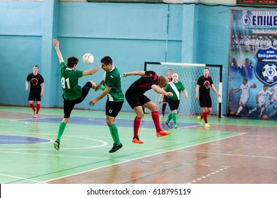 ODESSA, UKRAINE - April 7, 2017: Football on floor, minifootball. Futsal. Regional tournament of local football clubs on futsal. bright moment of sports game in football in closed hall, mini football