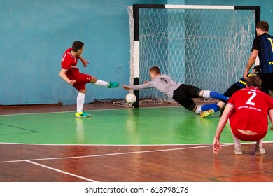 ODESSA, UKRAINE - April 7, 2017: Football on floor, minifootball. Futsal. Regional tournament of local football clubs on futsal. bright moment of sports game in football in closed hall, mini football