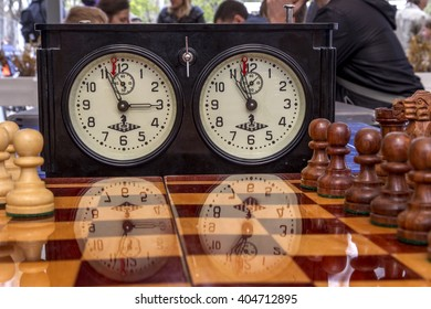ODESSA, UKRAINE - April 9, 2016: The city chess tournament. Players chess concentrate and think on their own. Chess background theme. Hobby playing chess