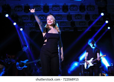Odessa, Ukraine August 10, 2014: Ibiza night club. Artist performs songs and club show  from stage during concert at nightclub with lights show. Artist on club stage during night party.