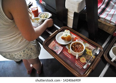 "ODESSA  / UKRAINE - AUGUST 14 2010: Bowl of borscht on a serving tray in the ""Evropa"" Shopping Center on Deribasivska Street serves ethnic Ukrainian food."