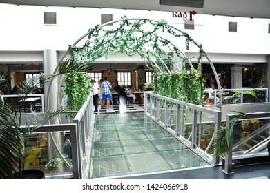 "ODESSA  / UKRAINE - AUGUST 14 2010: Trellised walkway in ""Puzata Hata"" cafeteria-style restaurant in the ""Evropa"" Shopping Center  on Deribasivska Street serves ethnic Ukrainian food."
