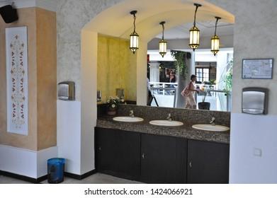 "ODESSA  / UKRAINE - AUGUST 14 2010: Wash basin to wash your hands at ""Puzata Hata"" cafeteria-style restaurant in the ""Evropa"" Shopping Center  on Deribasivska Street serves ethnic Ukrainian food."