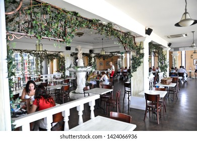 """ODESSA  / UKRAINE - AUGUST 14 2010: Diners in the dining room of """"Puzata Hata"""" cafeteria-style restaurant in the """"Evropa"""" Shopping Center  on Deribasivska Street which serves ethnic Ukrainian food."""