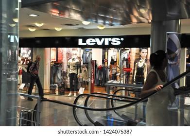 "ODESSA  / UKRAINE - AUGUST 14 2010:  The ""Levi's"" clothing store  and escalator inside the ""Evropa"" Shopping Center  on Deribasivska Street."