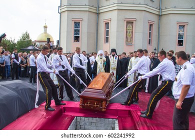 Odessa, Ukraine August 14, 2013: Slavonic funeral with burial of deceased in temple and burial in cemetery. Funeral service. Funerals in Orthodox traditions.