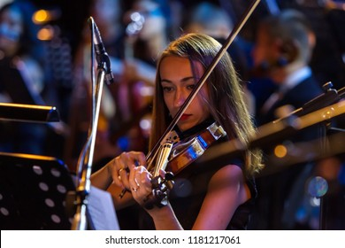 ODESSA, UKRAINE August 14, 2018: Musical show, Variety Symphony Orchestra on the stage of Odessa National Opera and Ballet Theater. Orchestra instruments on stage, musicians on stage of the theater
