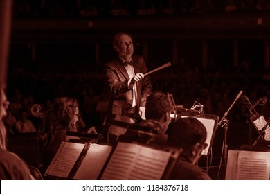 ODESSA, UKRAINE August 14, 2018: Musical show, Conductor Vitaliy Kovalchuk Variety Symphony Orchestra on the stage Theater. Orchestra instruments on stage, musicians on stage of the theater