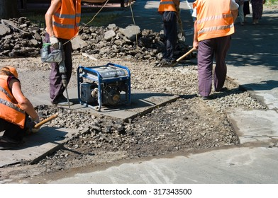 Odessa, Ukraine August 15, 2015: - repair of asphalt pavements and roads in the city center. patch holes in the asphalt on the roadway and the pedestrian. Job asphalt surfacing machines
