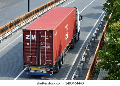 Odessa / Ukraine - August 16 2019: Transportation of  ZIM Integrated Shipping Services Ltd. sea container by vehicle trailer