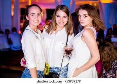 Odessa, Ukraine August 2, 2014: Bono beach club. Women smiling and posing on cam during concert in night club party. Girl have fun at club. girl at night club party