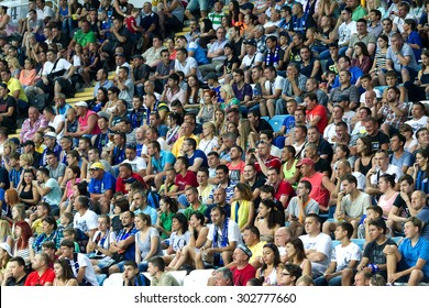 ODESSA, UKRAINE - August 2, 2015: Football fans and spectators in the stands of the stadium emotionally support their team during the game FC Dynamo Kyiv - Chernomorets Odessa. Major League.