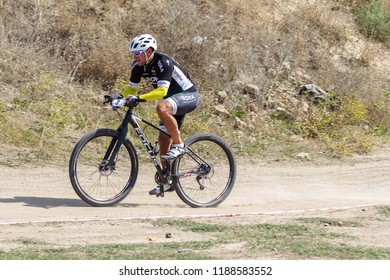 ODESSA, UKRAINE - August 2, 2018: Athletes on sports bicycles compete on mountainous terrain. Family sports leisure with children, healthy way of life, Cyclocross - day off sport in nature