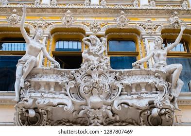 Odessa, Ukraine - August 2017: Sculptures of modernist style on the balcony of Odessa Passage.