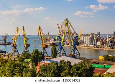 ODESSA, UKRAINE - August 2018: Odessa port aerial view, cargo cranes and containers in Odessa port, Ukraine
