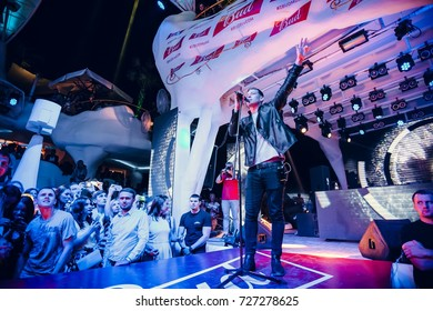 Odessa, Ukraine August 22, 2015: Artist Chris Jones and Richard Durand performs songs and club show from stage during concert at nightclub. Artist on club stage during night party.