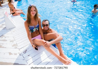 Odessa, Ukraine August 22, 2015: Men and women relaxing in luxury beach resorts during summer holidays. Boy and girl rest on day lounge party at elite beach resorts of Ibiza.