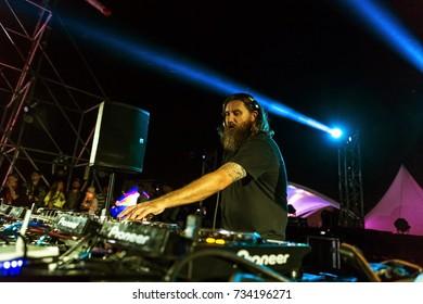 ODESSA, UKRAINE - August 22, 2017: famous DJ Pendulum plays on night scene of music festival Z-GAMES. DJ Pendulum performing at concert at Night club