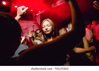 Odessa, Ukraine August 23, 2015: Ibiza club. People smiling and posing on cam during concert in night club party. woman have fun at club. girl at night club party