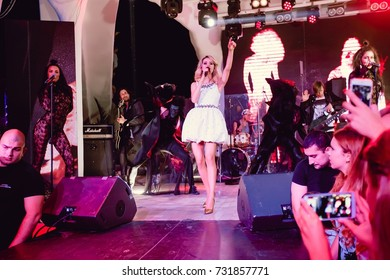 Odessa, Ukraine August 24, 2015: Ibiza night club. Artist Svetlana Loboda performs songs from stage during concert at nightclub. Artist on club stage during night party.