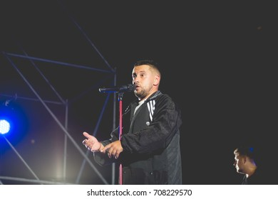 Odessa, Ukraine August 24, 2017: Famous Ukrainian artist Monatik performs songs from stage during concert at open air nightclub. Artist on stage during night party.