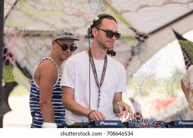 Odessa, Ukraine August 24, 2017: dj playing good music at summer beach party during open air festival. Day lounge party at summer beach festival of club and rock musik.