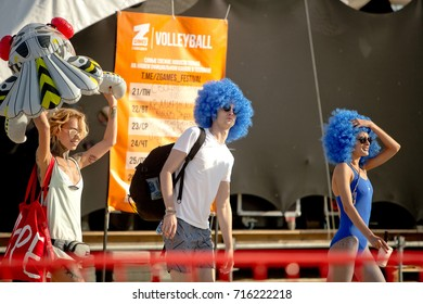 Odessa, Ukraine August 24, 2017: Summer beach party. People dancing at beach party. large crowd of spectators during music show during day. Spectators in sand of beach during music open air festival