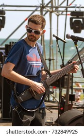 ODESSA, UKRAINE - AUGUST 24, 2017: most popular Russian rock musician Noize MC on stage during preparation for concert at an outdoor playground on beach during the Z-Games music festival