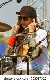 ODESSA, UKRAINE - August 24, 2017: Musician is drummer of music group of popular Russian rapper, rock musician Noize MC. drummer behind drum set at concert. Preparation for evening concert