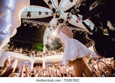 Odessa, Ukraine August 25, 2015: Ibiza Night club dj party people enjoy of music dancing sound with colorful light, smoke machine, lights show and artist Svetlana Loboda show on night club stage.