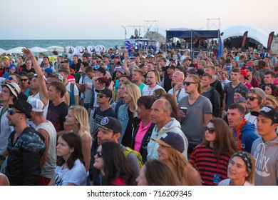 Odessa, Ukraine August 25, 2017: crowd with arms outstretched at concert. cheering crowd at concert on sea coast. Crowd at music concert, audience raising hands up. outdoor festival club party