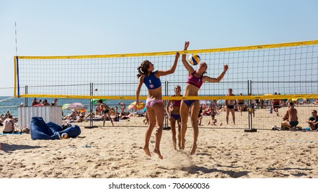 ODESSA, UKRAINE - August 26, 2017: Ukrainian Beach Volleyball Championship on  sea beach during the Z-Games Festival. Men and women play volleyball on beach sand. Volleyball on sand. Beach volleyball