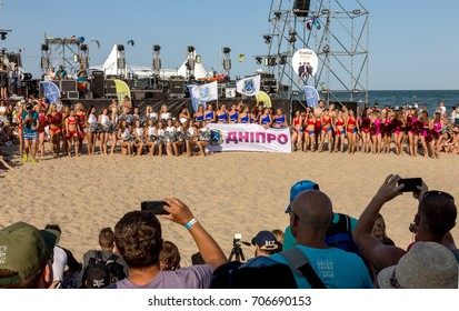 ODESSA, UKRAINE - August 26, 2017: Championship of Ukraine in cheerleading at sea during festival Z-Games. Beautiful young sports girls cheerleaders perform in sand of beach at festiva