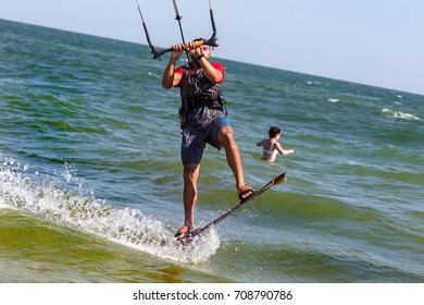 ODESSA, UKRAINE - August 26, 2017: Kiteboarding. Entertainment in sea waves, Extreme sports Kitesurfing. Recreational activities, water sports, action, hobbies and fun in summer. Kiteboarding Sports