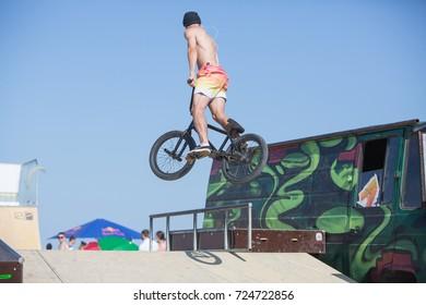Odessa, Ukraine August 26, 2017: Extreme bike rider jumping. Unidentified BMX rider making a bike jump during the BMX Competition. Dirt