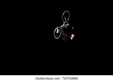 Odessa, Ukraine August 26, 2017: Extreme bike rider jumping. Unidentified BMX rider making night bike jump during the BMX Competition. Night Dirt