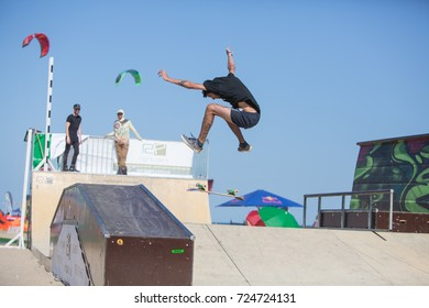 Odessa, Ukraine August 26, 2018: Athletes compete in skateboard competition. Skateboarder on ramp. Outdoor skate contest. extreme sport competition skateboarders. Young skater jump high on mini ramp.