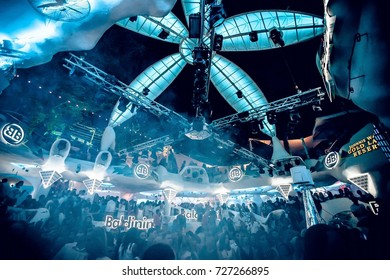 Odessa, Ukraine August 28, 2014: Ibiza Night club dj party people enjoy of music dancing sound with colorful light, smoke machine, lights show and dance show. Hands up in the earth.