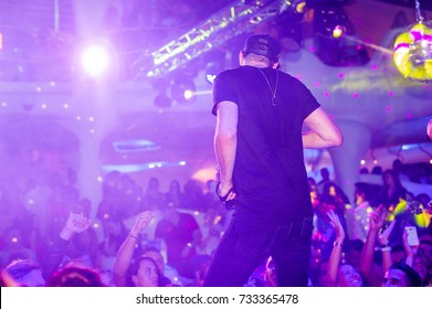 Odessa, Ukraine August 29, 2015: Ibiza night club. Group The Party Makers performs songs from stage during concert at nightclub. Artist on club stage during night party.