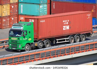 Odessa / Ukraine - August 30 2019: Transportation of ZIM sea container by vehicle trailer. Container terminal CTO in port of Odessa