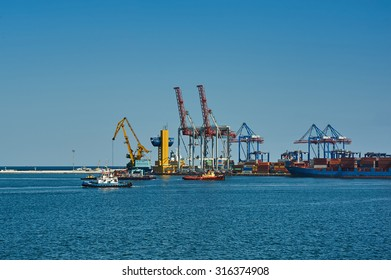 Odessa, Ukraine - August 31, 2015: Cargo cranes on rails and cargo warehouses in the seaport
