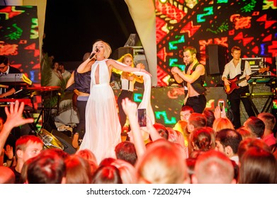 Odessa, Ukraine August 7, 2015: Russian artist Polina Gagarina performs songs and club show from stage during concert at nightclub. Artist on club stage during night party.