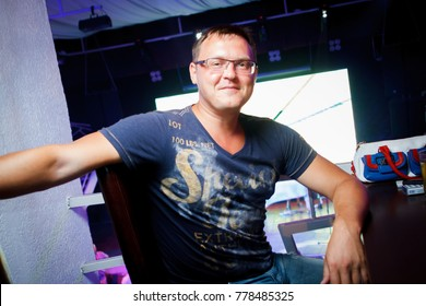 Odessa, Ukraine August 7, 2015: Metropolis night club. People smiling and posing on cam during concert in night club party. Man have fun at club. Boy at night club party