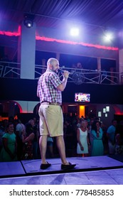 Odessa, Ukraine August 7, 2015: Artist performs songs from stage during concert at nightclub. Artist on club stage during night party.