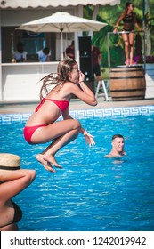 Odessa, Ukraine August 7, 2016: Privat Elling beach club.  girl in bikini posing on cam during day pool party at summer holidays time. Woman rest in luxury beachfront complex. Day lounge party