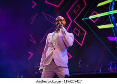 Odessa, Ukraine August 7, 2018: World famous musik band Mr. President (LayZee) performs songs from stage during concert at nightclub. Artist on club stage during night party.