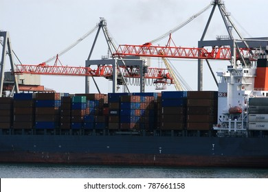 ODESSA, UKRAINE - CIRCA 2008: Industrial container cargo cargo ship with a working crane. Cargo container ship in the dock. Delivery of containers. Logistics import export and transport industry