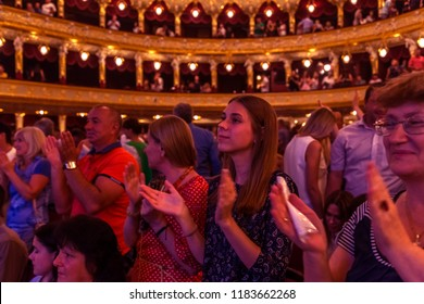 ODESSA, UKRAINE -CIRCA 2018: Large crowd of Spectators in auditorium of concert hall emotionally meet their favorite performers. Audience in theater hall. Viewers like performance on stage of theater