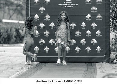 Odessa, Ukraine - CIRCA 2020: Children's Fashion Show. Presentation of young models in fashionable clothes on the red carpet defile. Models walk the runway at the presentation of the collection