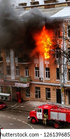 Odessa, Ukraine - Dec. 29, 2016: A fire in an apartment building. Strong bright light and clubs, smoke clouds window of their burning house. Firefighters extinguish fire in house. Work on fire stairs